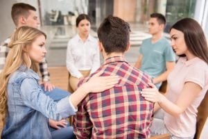 Group therapy at one of mental health care systems or rehabs.